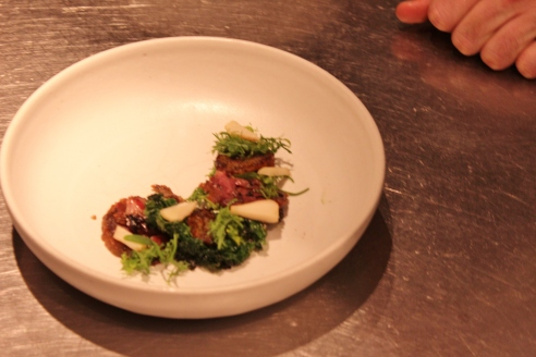 Tete de Cochon, Seared Koji Cake, Crispy Kale, Pickled Turnips and Their Greens, Pine Broth